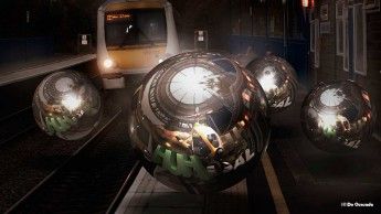 3d gallery orbs howering over the train tracks at the train station