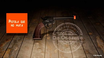Graphic design gallery childrens plastic gun hovering above the wooden floor