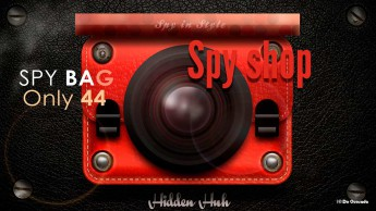 Graphic design gallery red bag with a spy camera on the black leather background